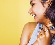 Lifestyle people concept. young pretty smiling indian girl with long nails wearing lot of jewelry rings, asian summer Stock Photo