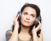 Lifestyle  and people concept: Young woman with headphones liste Stock Photography