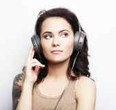 Lifestyle  and people concept: Young woman with headphones liste Stock Photo