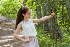 Lifestyle photo beautiful girl photographed on the smartphone Royalty Free Stock Images