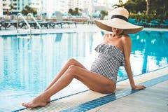 Beautiful pregnant woman in swimming pool royalty free stock image