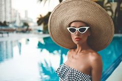 Beautiful woman in swimming pool royalty free stock images