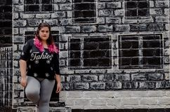 Lifestyle portrait of a beautiful young plus size woman stock photography