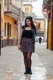 Lifestyle portrait of a beautiful young plus size woman. Smiling at camera in the city street royalty free stock photography