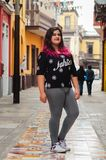 Lifestyle portrait of a beautiful young plus size woman. Smiling at camera in the city street stock photography