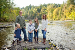 Lifestyle Portrait of a Five Person Family Outdoors. Lifestyle portrait of five people in a family along the banks of the McKenzie River in Oregon Royalty Free Stock Photos