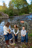Lifestyle Portrait of a Five Person Family Outdoors. Lifestyle portrait of five people in a family along the banks of the McKenzie River in Oregon Stock Images