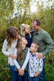 Lifestyle Portrait of a Five Person Family Outdoors. Lifestyle portrait of five people in a family along the banks of the McKenzie River in Oregon Stock Image