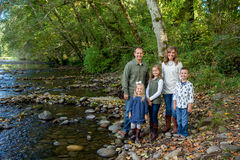 Lifestyle Portrait of a Five Person Family Outdoors. Lifestyle portrait of five people in a family along the banks of the McKenzie River in Oregon Royalty Free Stock Photo