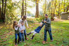 Lifestyle Portrait of a Five Person Family Outdoors. Lifestyle portrait of five people in a family along the banks of the McKenzie River in Oregon Royalty Free Stock Photography