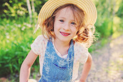 Lifestyle portrait of happy child girl in straw in summer Royalty Free Stock Photos