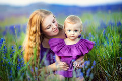 Lifestyle portrait mom and daughter in happines at the outside in the meadow Royalty Free Stock Photo