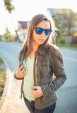 Lifestyle portrait of pretty young fashion brunette in sun glass Royalty Free Stock Photography