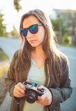 Lifestyle portrait of pretty young fashion brunette in sun glass Stock Images