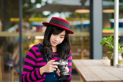 Lifestyle portrait of pretty young Photographer  woman Royalty Free Stock Images