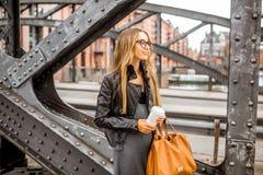 Business woman on the iron bridge Stock Photography
