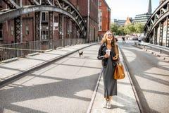 Business woman on the iron bridge Stock Image