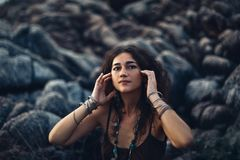 Lifestyle portrait of stylish young woman outdoors Stock Photos