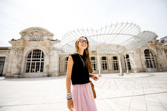 Woman near the old beautiful building in Vichy city, France Stock Photos