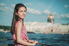 Lifestyle Portrait of young beautiful Caucasian woman with city background on the Neva River, in Saint Petersburg Royalty Free Stock Image
