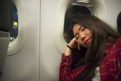Lifestyle portrait of young beautiful and sweet Asian Korean tourist woman sleeping on plane during long flight feeling tired taki stock images