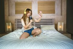 Lifestyle portrait of young cute and happy Asian Korean student stock image