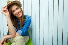 Lifestyle portrait of young woman sitting Stock Photos
