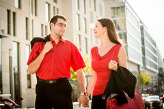 Lifestyle in red  - young people walking street Royalty Free Stock Photography
