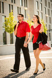 Lifestyle in red  - young people walking street Royalty Free Stock Photos