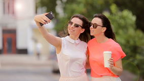 Lifestyle selfie portrait of two young positive woman having fun and making selfie. Concept of friendship and fun with. Portrait of two young positive woman stock video