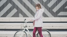 Lifestyle sport concepte. young woman with vintage bike in city parking. Nature color toning for design stock photo