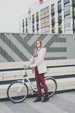 Lifestyle sport concepte. young woman with vintage bike in city parking. Nature color toning for design stock image