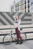 Lifestyle sport concepte. young woman with vintage bike in city parking. Nature color toning for design stock images