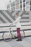 Lifestyle sport concepte. young woman with vintage bike in city parking. Nature color toning for design royalty free stock photography