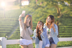 Lifestyle sunny image of best friend girls taking selfie on came Stock Photo