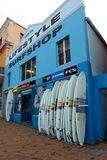 Lifestyle Surfshop. The blue front of a surfing store for surfers with surfboards at Muizenberg Beach, Cape Town, South Africa stock photo