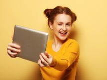 Lifestyle, tehnology and people concept: Happy girl  taking self Royalty Free Stock Photos