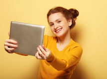 Lifestyle, tehnology and people concept: Happy girl  taking self Royalty Free Stock Image