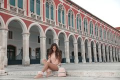 Lifestyle tourist girl visiting landmark of Republic Square sigh. Tseeing in Split, Croatia. European famous travel places royalty free stock photos