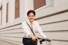 Lifestyle, transport and people concept - young man  on city str Stock Images