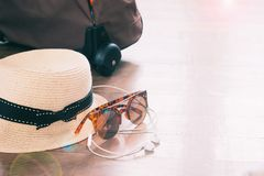 Lifestyle and travel items on wooden floor. Woman accessories Royalty Free Stock Image