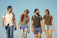 Lifestyle Wanderlust vacation travel hiking Happy friends on blue sky, wanderlust. Men and women travel on summer vacation. Friendship, friends, young people stock images