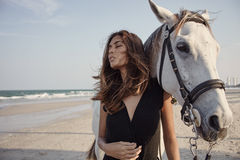 Lifestyle witth horse on the beach Stock Image