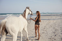 Lifestyle witth horse on the beach Stock Photo