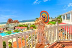Lifestyle woman in Coronado Island. Happy lifestyle tourist woman enjoying at a balcony of beachfront luxury hotel at in Coronado Island, San Diego. Summer royalty free stock photography