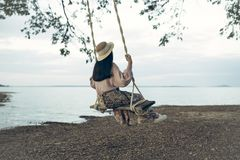 Lifestyle of woman happy relaxing. With swing at riverside Stock Photos