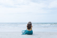 Lifestyle Woman Sitting On The Beach Royalty Free Stock Photos