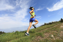 Lifestyle woman trail runner running on mountain peak Stock Photography