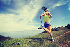 Lifestyle Woman Trail Runner Running On Mountain Peak Stock Photos