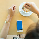 Lifestyle of women using a mobile phone in cafe Royalty Free Stock Photo